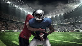 American football player tackling for ball. At stadium stock footage