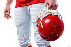 An american football player taking his helmet on her hand Royalty Free Stock Image