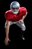 American football player taking position while playing Royalty Free Stock Photos