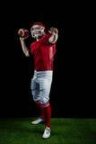 American football player throwing football Stock Photo