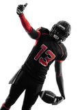 American football player thumb up  portrait silhouette Stock Photo