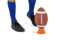 American football player about to kick ball Stock Photo