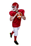 American football player about to make a pass Stock Photo