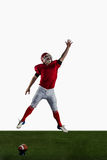 American football player trying to catch football Royalty Free Stock Photos