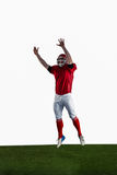American football player trying to catch football Royalty Free Stock Photo