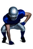 American football player in uniform bending Royalty Free Stock Images