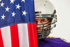 American Football Player with uniform and american flag proud of his country, on a white background. stock image