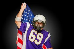 American Football Player with uniform and american flag proud of his country, on a white background. stock photos