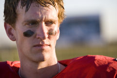 American football player wearing red football strip and black face paint, close-up, front view Stock Photography