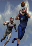 American football players. Two american football players in action with sky background Royalty Free Stock Photo
