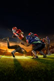 American football players in action on grand arena Stock Images