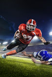 American football players in action on grand arena Stock Photo