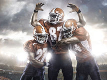 American football players in action on stadium Royalty Free Stock Photo