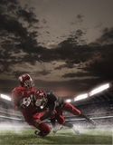 The american football players in action Stock Photos