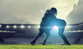 American football players at arena . Mixed media royalty free stock photos