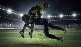 American football players at arena . Mixed media Stock Photography