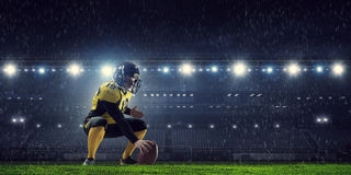 American football players at arena . Mixed media stock images