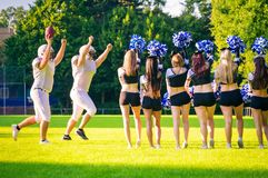 American Football Players With Cheerleaders. Team of american football players with cheerleaders Stock Photography