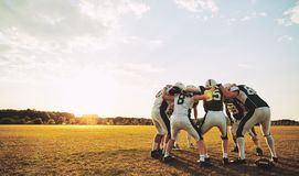 Free American Football Players In A Huddle During Practice Royalty Free Stock Photo - 132617385