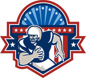 American Football QB Quarterback Crest. Illustration of an american football gridiron quarterback player throwing ball facing front set inside crest shield with Royalty Free Stock Photo