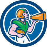 American Football Quarterback Bullhorn Cartoon. Illustration of an american football gridiron quarterback player holding bullhorn blowhorn shouting facing side Royalty Free Stock Photos