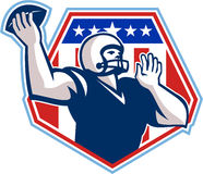 American Football Quarterback Shield. Illustration of an american football gridiron quarterback player throwing ball facing side set inside crest shield with Royalty Free Stock Image