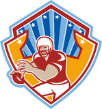 American Football Quarterback Star Shield. Illustration of an american football gridiron quarterback player throwing ball facing front set inside crest shield Stock Photo