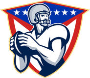 American Football Quarterback Throw Ball. Illustration of an american football gridiron quarterback player throwing ball facing side set inside crest shield with Royalty Free Stock Photo
