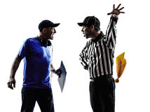 American football referee and coach conflict dispute. Conflict dispute in silhouettes on white background stock photography