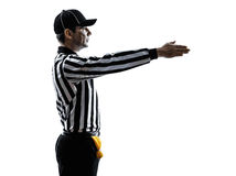 American football referee gestures first down silhouette. American football referee gestures first down in silhouette on white background royalty free stock images