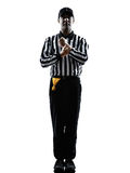 American football referee gestures holding silhouette. American football referee gestures holding in silhouette on white background stock photos