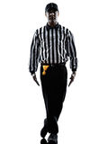 American football referee gestures tripping silhouette. American football referee gestures tripping in silhouette on white background Stock Photography