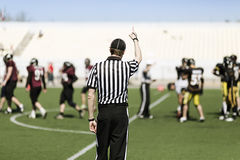 American football referee with hand up Stock Photography