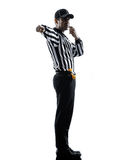 American football referee whistling silhouette Stock Images