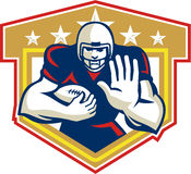 American Football Running Back Fending Shield. Illustration of an american football gridiron running back player running with ball facing front fending set Stock Image