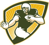 American Football Running Back Shield. Illustration of an american football gridiron running back player running with ball facing front done in retro style set Royalty Free Stock Photo