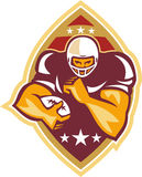 American Football Running Back Star Ball. Illustration of an american football gridiron running back player running with ball facing front done in retro style Stock Photography