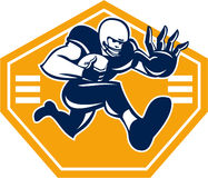 American Football Running Back Stiff Arm. Illustration of an american football gridiron running back player running with ball facing front fending putting out a Royalty Free Stock Images