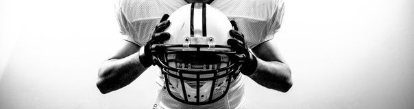 American Football runningback quarterback take a helmet stock images