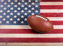 American football on rustic wooden USA flag Stock Photo