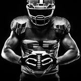 American football sportsman player. On black background stock images