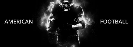American football sportsman player on black background running in action. Sport wallpaper with copyspace. American Football player on stadium with smoke and stock photography