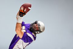 American football sportsman player on black background. Sport concept. stock images
