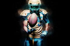 American football sportsman player isolated on black background royalty free stock photos