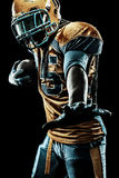 American football sportsman player isolated on black background. American Football player isolated on black background Stock Photo