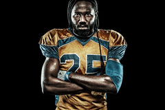 American football sportsman player isolated on black background. American Football player isolated on black background Royalty Free Stock Photography