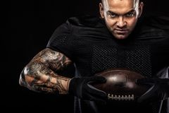 American football sportsman player isolated on black background. American Football player isolated on black background Royalty Free Stock Image