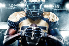 American football sportsman player on stadium with lights on background Royalty Free Stock Photos