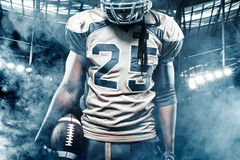 American football sportsman player on stadium with lights on background Stock Images