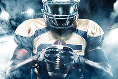 American football sportsman player on stadium with lights on background royalty free stock photo